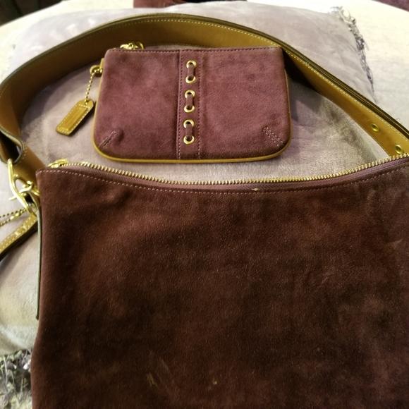 Burgundy Coach purse and wristlet